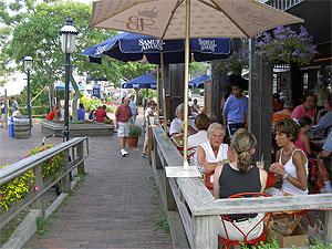 Enjoying lunch at the Tavern, Straight Wharf Nantucket. photo: Max Hartshorne