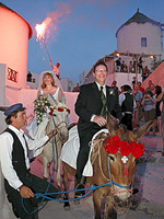 They took their vows beneath the magnificent Santorini sunset.