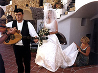 They were led by a procession of Greek musicians strumming on their instruments in honor of the newlywed bride and groom.