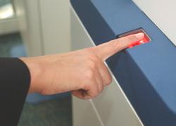 Biometric fingerprint reader at the Clear Lane.
