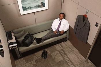 A man relaxes in a Minute Suite.
