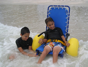 Even the beach is within your reach with specially adapted beach wheelchairs. Photo by Special Needs Group.