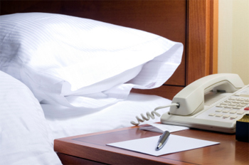 Think twice before you pick up the hotel phone to make a long distance call. It could be very, very expensive.