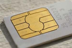 A removable mobile phone SIM card.