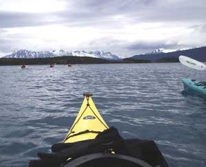 Sea kayaking toward the mountains
