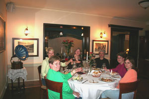 At dinner, the small groups often form strong bonds on trips.