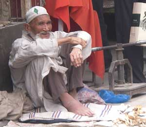 A man selling wooden spoons