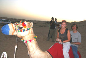 Lisa riding a camel in Dubai