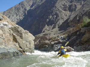 Robert Bart, a kayaker from Hood River, Oregon, makes his way down the Cotahuasi amid the scenery of ancient Incan terraces (right).