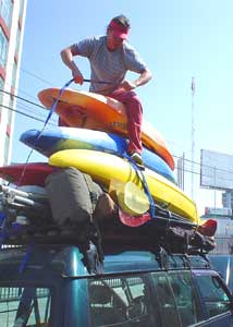 Loading up gear, raft, and kayaks atop a van in Areqippa, Peru for the 12 hour drive to Cotahuasi