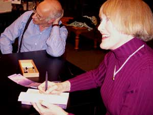 Catherine Watson signs copies of her book.