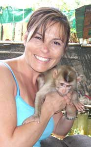 Theresa Rodriguez Williamson with a monkey in Thailand