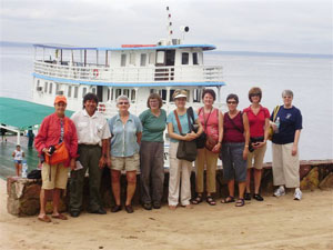 A group of the 'Amazon Princesses' and guide pose in front of the Tucano.