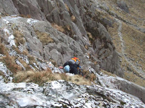 A climber scaling the icy cliffs of Cwm Idwal (photo by Abbey Stirling)