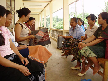 The women in the Ban Hai village meet to discuss textile designs, marketing and pricing.
