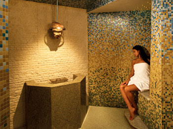Inside the Herbal Laconium at the Canyon Ranch Spa, the air is heavy with a heral-infushed humidity