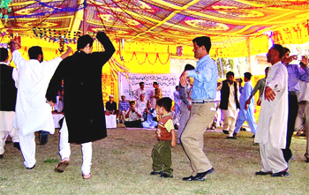 Men dance at the mass wedding in Northern Pakistan. photos by Heather Carreira