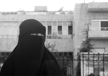 A woman wearing a burqa in Jordan. Photo by JK Daley.