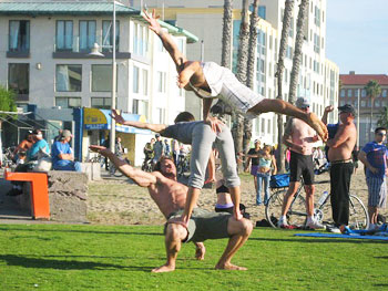 Human Art: The beach scene at Venice features side shows such as this amazing acrobat feat. Photos by Ingrid Hart.