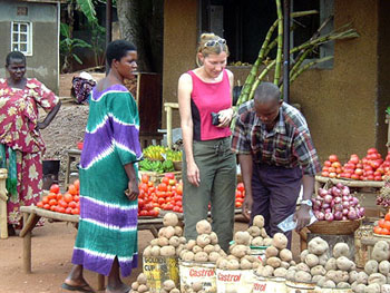 Marie Javins shops at a market in Uganda.