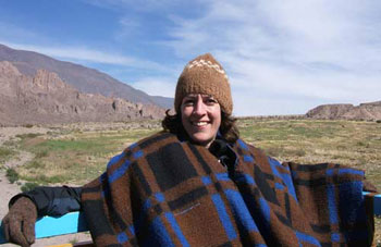 Polly Evans wraps herself in wool to ward off the chilly air outside the city of Salta in northern Argentina.