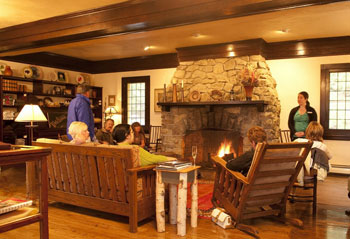 A massive fireplace warms the lobby of the Belton Chalet, a quaint lodge just outside of Glacier National Park. Photo by Donnie Sexton.