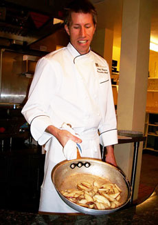Chef Andy Blanton of Cafe Kandahar gives a private demonstration of how he sautees slices of pear for his pear-ginger-white chocolate tart. Photo by Kelly Westhoff.