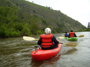 While kayaking on the Clark Fork River above the city of Missoula, we spotted eagles and osprey. Eventually, our float brought us right into town, where we pulled our boats out in a downtown park. Photo by Suzanne Ahearne.