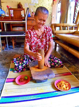 A Jamu preparing ingredients at her house