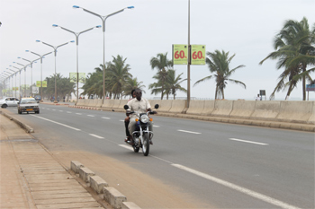 Motorcycle taxi in Lome, Togo. Photos by Raquel Fletcher.