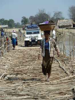 A bridge made of bamboo replaced one that washed away in a storm last year.