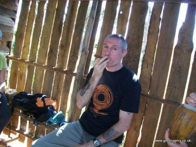 Enjoying a Cuban cigar in Vinales, Cuba.