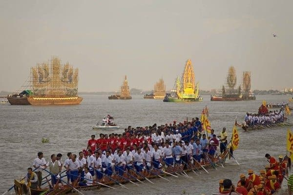 Huge boats line the riverside at the Bon Om Touk festival every year.