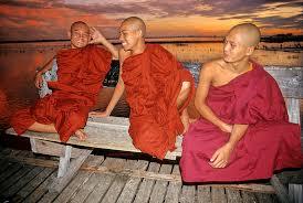 Monks on a bridge. Photo by Gina Reisner