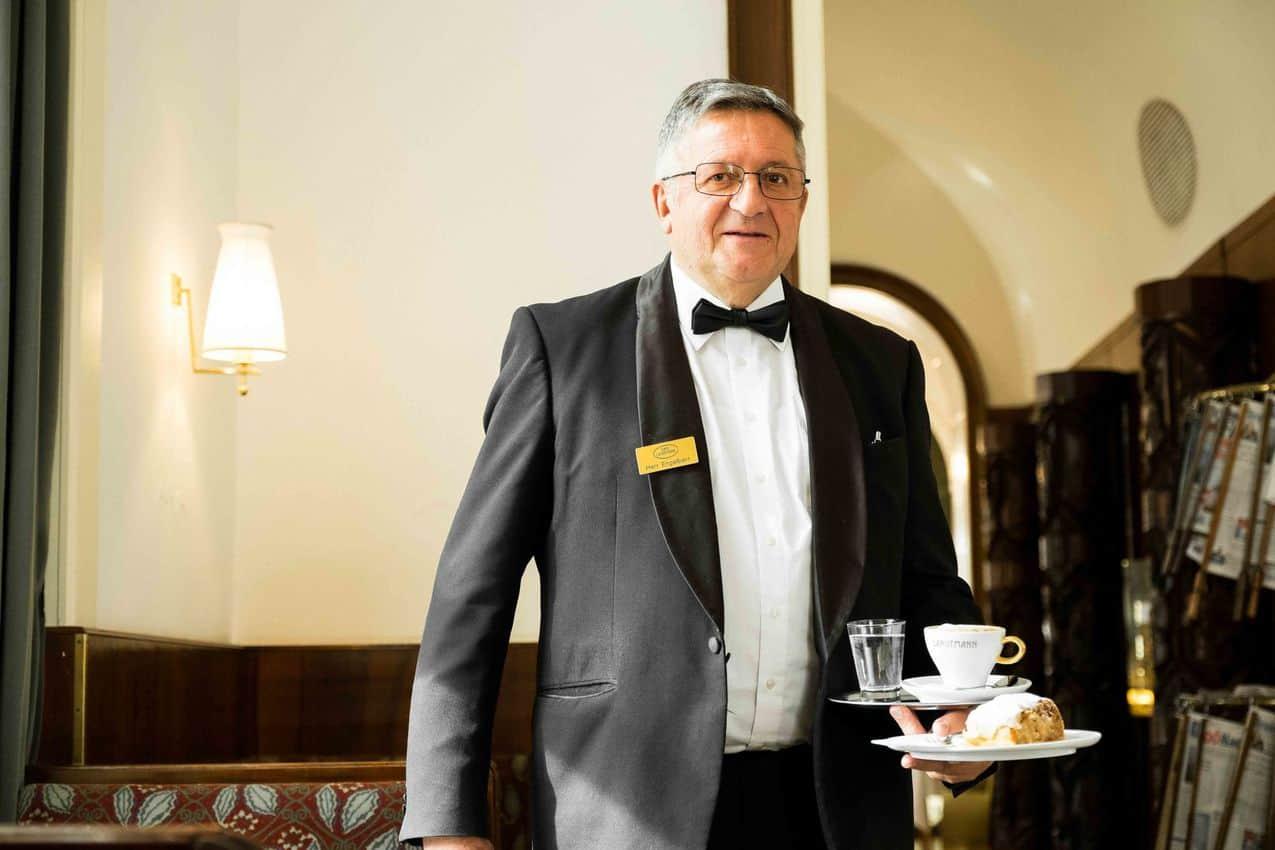 Professional cafe waiter at Cafe Landtmann in Vienna Austria.