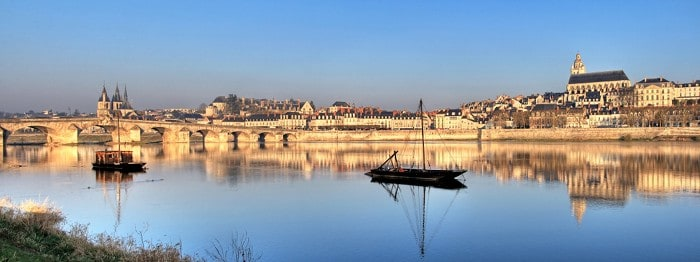 Panoramic view of bridge and cathedral of  Blois reflected in the river . Valley of Loire , France