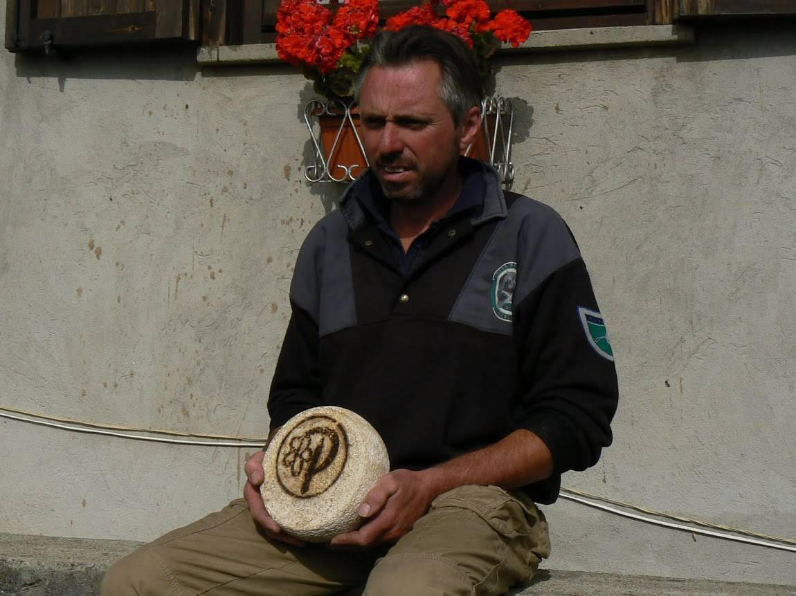 A local cheesemaker shows us his goat cheese in the Alps.
