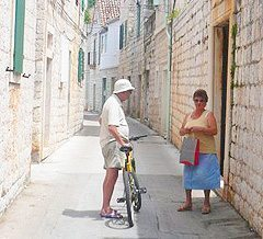 Neighbors chatting in Vis, Croatia.