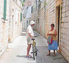 Neighbors chatting in Vis, Croatia.