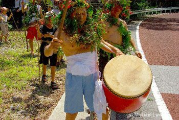 An elder, beating a drum at the Shinugu Festival in Okinawa, Japan – photos by Michael Lynch