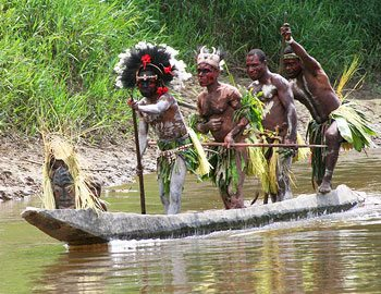 Villagers in Papua New Guinea return from a hunt. Photo by Kent St. John.