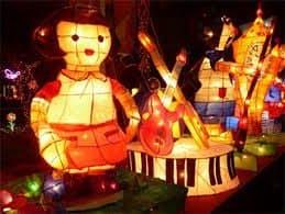 The lanterns are illuminated at dusk.