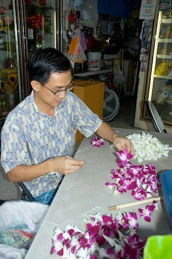 A lei maker in Chinatown, Honolulu. photos by John Peniston.