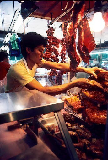 Meat cutter in the Honolulu Chinese Market.