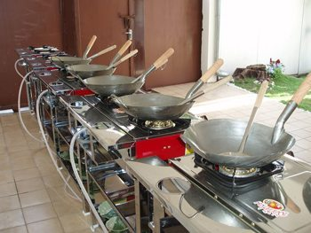 Thai cooking woks, ready for action.
