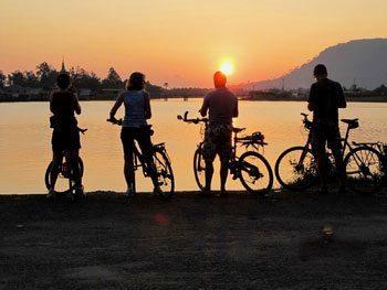 Cyclists enjoying the Cambodian sunset
