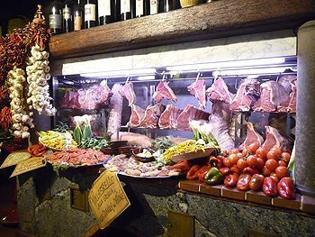 Bistecca alla Fiorentina and assorted foods ready for diners at Ristorante Perseus.