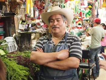 A herb-seller in a Mexico City market.
