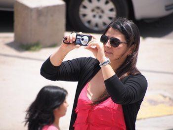 woman-camera outside the Soumaya Museum, Mexico City.