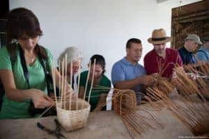 Weaving baskets of bamboo, part of the coffee plantation experience.